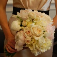 bride's bouquet of poenies, roses, and freesia