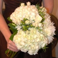 Bride's bouquet of hydrangea, fresia, roses, and hypericum
